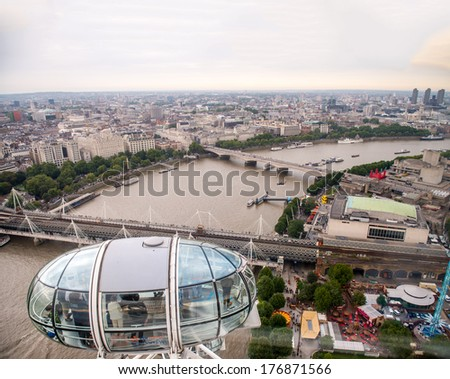 LONDON - SEP 15, 2013: View of capsule and city skyline from London Eye. With diameter of 120 meters and height of 135 meters, it is the highest ferris wheel in Europe