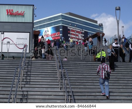 LONDON- SEPT 13: Crowds of shoppers visit Londons newest and biggest shopping centre, Westfield Stratford city, on its opening day in London on Sept 13, 2011. - stock photo