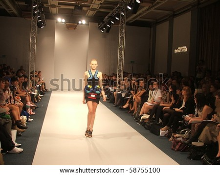 LONDON - SEPTEMBER 20: A model walks the runway for the David Koma Spring/ Summer Collection 2010 at London Fashion Week on September 20, 2009 in London - stock photo