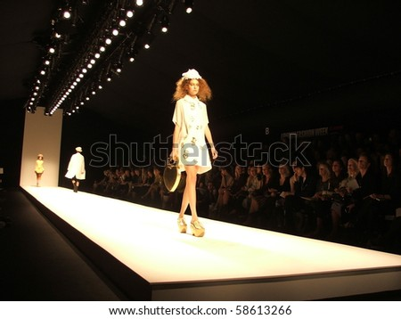 LONDON - SEPTEMBER 19: A model walks the runway for the John Rosha Spring/ Summer Collection 2010 at London Fashion Week on September 19, 2009 in London - stock photo