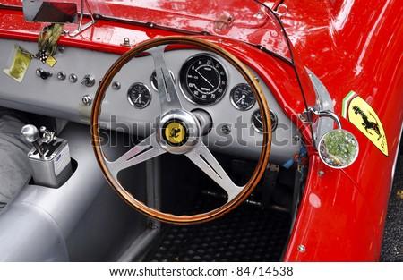 LONDON - SEPTEMBER 04: A vintage Ferrari at Chelsea AutoLegends, on September 04, 2011 in London. Ferrari was founded by Enzo Ferrari in 1929. - stock photo
