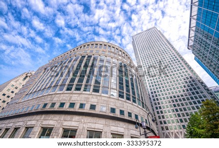 LONDON - SEPTEMBER 28, 2013: Buildings of Canary Wharf as seen from street level. Canary Wharf is a major business district located in Tower Hamlets, London. - stock photo