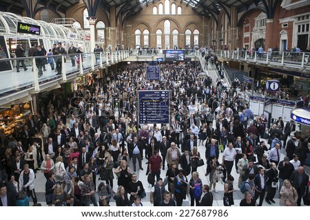 LONDON - SEPTEMBER 30 : COMMUTERS are facing train chaos tonight as trains out of London Liverpool Street are being cancelled on September 30, 2014 on the Liverpool street Station  in London, England. - stock photo