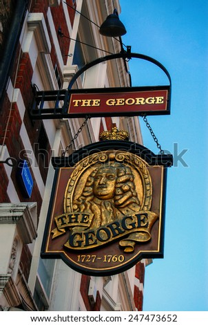 "LONDON - September 20 .2014: English pub sign ""the George"". Public house, known as pub, is focal point of community, on London, UK.  - stock photo"