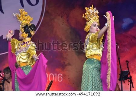 LONDON - SEPTEMBER 24: Malaysian Cultural Dancers performing the Timang Burung Dance at the Malaysia Fest 2016 in Trafalgar Square, London, UK, SEPTEMBER 24, 2016. The festival is now in its 7th year.