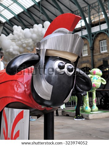 LONDON - SEPTEMBER 24, 2015. One of Aardman Animation's individually painted Shaun the Sheep character sculptures on final display at Covent Garden Market London, before auctioning for charity.