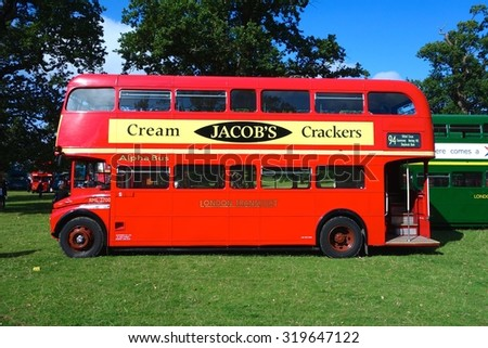 LONDON - SEPTEMBER 20: Routemaster Bus operating in London on September 20, 2015 in London, UK. The open platform facilitated speedy boarding under the supervision of a conductor.  - stock photo