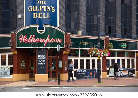 LONDON - SEPTEMBER 5TH: The exterior of the Gilpin's Bell Pub on September the 5th, 2014, in London, England, UK. Wetherspoon's is the uk's biggest pub chain. - stock photo