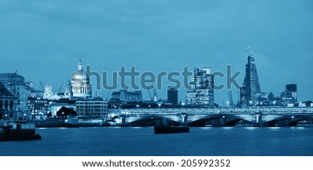 London skyline at night with bridge and St Pauls Cathedral over Thames River. - stock photo