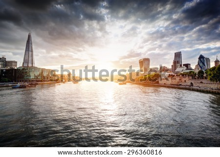 London skyline at sunset, England the UK. Tower of London, The Shard, City Hall, River Thames. Seen from Tower Bridge - stock photo
