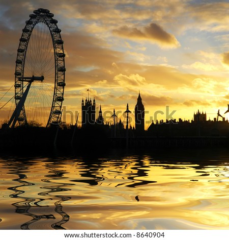 London skyline reflected in the Thames river at sunset - stock photo
