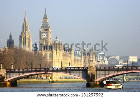 London skyline, Westminster Palace, Big Ben and Central Tower, seen from South Bank - stock photo
