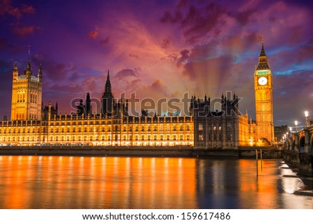London. Spectacular night view of Westminster and Thames river at sunset. - stock photo
