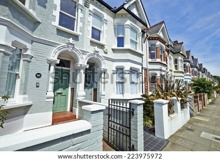 London street of early 20th century Edwardian terraced houses in a sunny day - stock photo