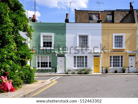 London street of small terraced houses, without parked cars. - stock photo
