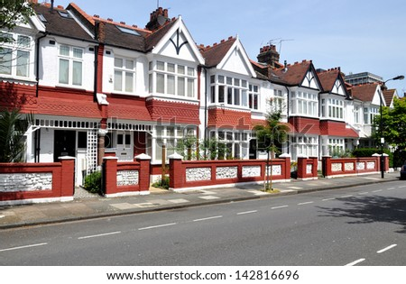 London Street of typical small Edwardian terraced houses, without parked cars. - stock photo
