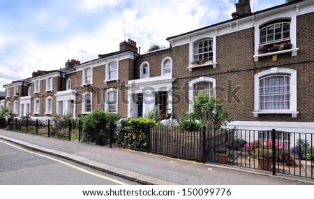 London street of typical small 19th century Victorian terraced houses without parked cars. - stock photo