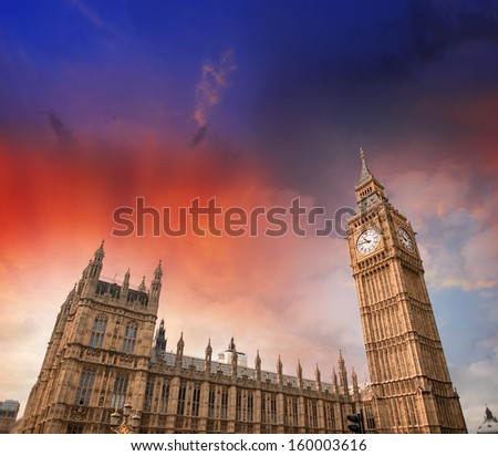 London. Street view of Westminster Palace and Big Ben Tower on a beautiful summer sunset. - stock photo