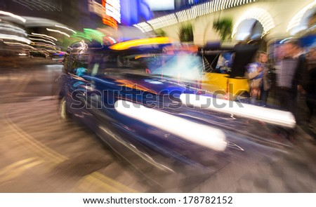 London. Taxi cab blurred motion, street photography.