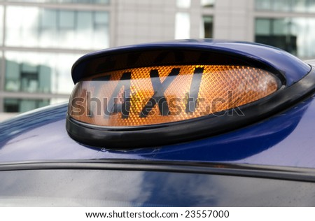 London taxi.London taxi with its for hire light turned on. - stock photo