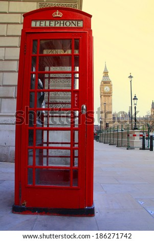 London telephone box and Big Ben in background - stock photo