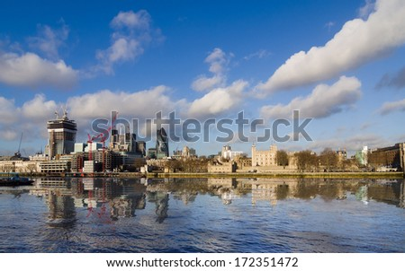 London, Thames river sightseeing on boat, you can see the famous london tower and Financial District. - stock photo