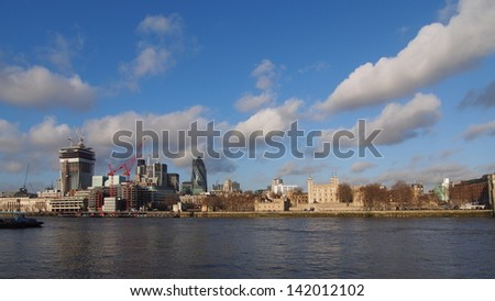London, Thames river sightseeing on boat, you can see the famous london tower and Financial District - stock photo
