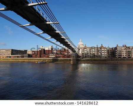 London, Thames river sightseeing on boat, you can see  the Millennium Bridge and St Paul's Cathedral - stock photo