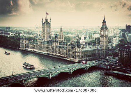 London, the UK. Big Ben, the Palace of Westminster in vintage, retro style. The icon of England. View from the London Eye - stock photo