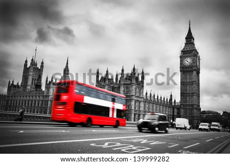 London, the UK. Red bus in motion and Big Ben, the Palace of Westminster. The icons of England - stock photo