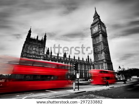 London, the UK. Red buses in motion and Big Ben, the Palace of Westminster. The icons of England in black and white with red colour. - stock photo