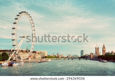 London, the UK skyline in vintage retro style. Big Ben, River Thames seen from Golden Jubilee Bridges. English symbols. - stock photo