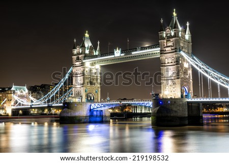 London Tower Bridge, is a combined bascule and suspension bridge on the Thames River. It is a European landmark and an iconic symbol of London, England, United Kingdom. - stock photo