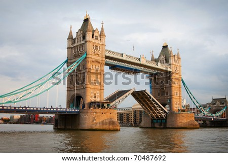London Tower Bridge with open gates at sunset - stock photo