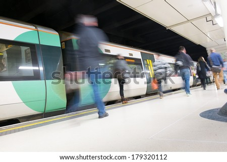 London Train Tube station Blur people movement in rush hour