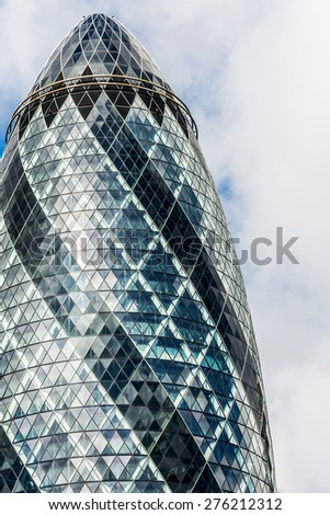 LONDON, UK - APR 11: 30 St Mary Axe (aka The Gerkin) skyscraper in the City of London on April 11, 2015. The building was designed by Norman Foster and Arup Group and it was erected by Skanska. - stock photo