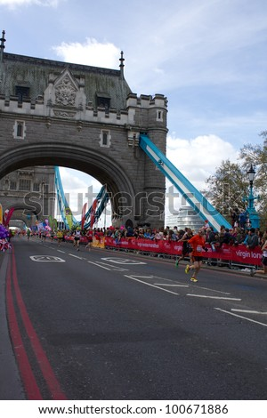 LONDON, UK - APR. 22: Tens of thousands of people pass Tower Bridge during the London Marathon on the Apr 22, 2012 in London, UK