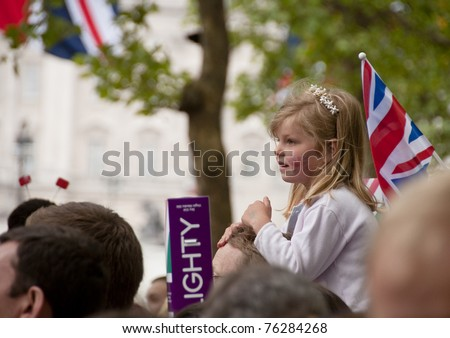 LONDON, UK - APRIL 29: A young unidentified girl at Prince William and Kate Middleton wedding, April 29, 2011 in London, United Kingdom - stock photo