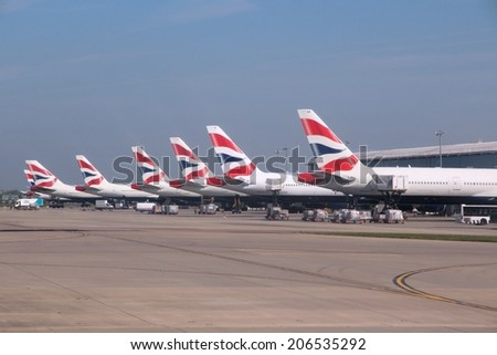 LONDON, UK - APRIL 16, 2014: British Airways Boeing 777s at London Heathrow airport. BA operates fleet of 283 aircraft (largest in the UK) and is largest operator of 747 with 55 aircraft (2014). - stock photo
