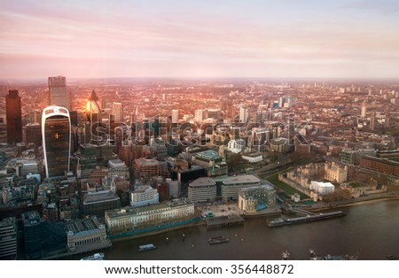 LONDON, UK - APRIL 15, 2015: City of London business and financial aria view at sunset - stock photo