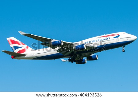 London, UK, April 9 2011: 4-engines Boeing 747 of British Airways carrier landing at Heathrow airport. - stock photo