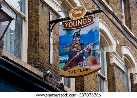 LONDON, UK - April 13, 2015: English pub sign, Public house, known as pub, is focal point of the community - stock photo