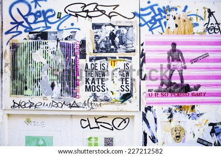 LONDON, UK - APRIL 18, 2014: Graffiti, posters and stickers on Brick Lane, Banglatown,  Spitalfields / Whitechapel.  - stock photo