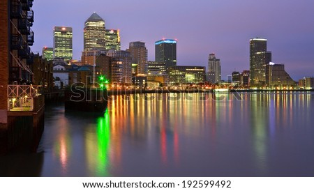 London, UK - April 6 2011: Looking towards Canary Wharf from Limehouse Basin over river Thames.