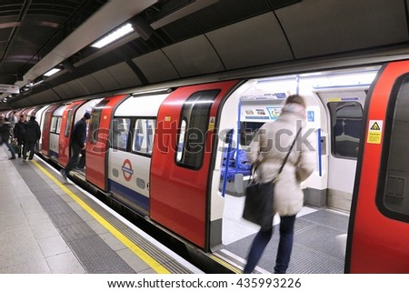 LONDON, UK - APRIL 22, 2016: People ride the Tube in London, UK. London Underground is the 11th busiest metro system worldwide with 1.1 billion annual rides. - stock photo