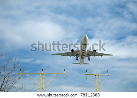LONDON, UK - APRIL 9: Qatar Airways Airbus A330 is on approach to land at Heathrow Airports on April 9, 2010 in London, UK. It is known as one of the worlds busiest international airports with over 90 airlines flying to 170 destinations worldwide. - stock photo