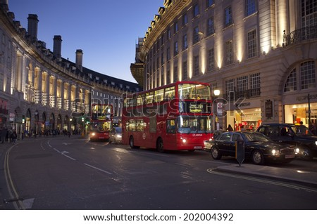 LONDON, UK - APRIL 16, 2014: Regent Street at Piccadilly Circus with red doubledecker buses. - stock photo
