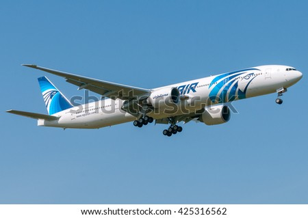 London, UK, April 9th 2011: a Boeing 777 of national airline Egyptair in short final for landing at Heathrow. - stock photo
