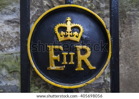 LONDON, UK - APRIL 10TH 2016: Queen Elizabeth II symbol on a gate at the Tower of London, on 10th April 2016. - stock photo