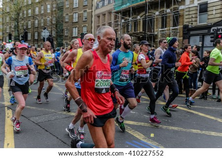London, UK - April 24, 2016: The London Marathon is a huge annual sporting event and attracts around 30,000 runners, most raising money for charity. - stock photo